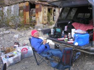 Breakfast on the truck tailgate near an abandoned mine